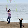 JIM VAIKNORAS/Staff photo Aurea Santiago of Lowell flies a kite with her grandson Caleb Mason, 3, of Pelham NH on Salisbury Beach Sunday afternoon.