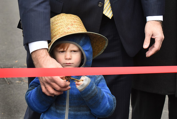 BRYAN EATON/Staff photo. Reid Jackson Langlois, 3, of South Hampton, N.H., grandson of James E. Reid, also from South Hampton, N.H. and who is Poet John Greenleaf Whittier's great-great-great grandnephew, helped in the ribbon cutting with the aid of state Rep. James Kelcourse.