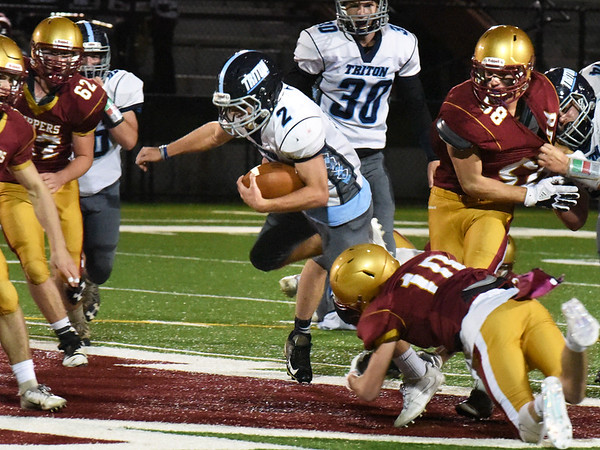 BRYAN EATON/Staff photo. Triton's Ethan Tremblay gets grabbed by Thomas Murphy.