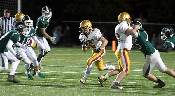 JIM VAIKNORAS/Staff photo  Newburyport's Seamus Webster returns a kick against  Pentucket during their game Friday night at World War Memorial Stadium in Newburyport.