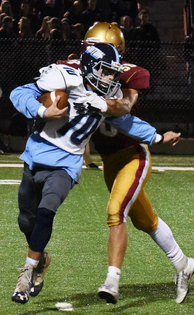 BRYAN EATON/Staff photo. Newburyport's Walker Bartkiewicz tackles Triton's Cameron Gilroy for a loss of yards.