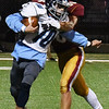 BRYAN EATON/Staff photo. Newburyport's Walker Bartkiewicz tackles Triton's Cameron Gilroy for a loss of yards.