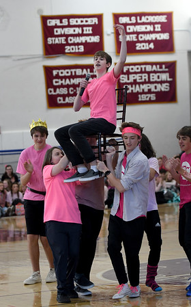 JIM VAIKNORAS/Staff photo Nate Hall as Brave, Brave Sir Robin is carried around by cast of the Newburyport High School production of Spam-A-Lot at the Recognition Rally at the school Friday. The rally honored students in different activities, like sports , band, arts , and civics clubs.