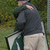 JIM VAIKNORAS/Staff photo Paula Garrant get a hug from Pentucket Atlhetc Director Dan Thorton during a ceremony before Saturday's game against Newburyport. Garrent was presented her son Reid's framed football jersey.  Reid  passed away this past summer after battling leukemia.