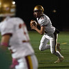 JIM VAIKNORAS/Staff photo Newburyport's SCharles Cahalane looks downfield for a receiver at North Reading Friday night.