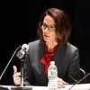 JIM VAIKNORAS/Staff photo  Jennifer Rocco Runnion speaks during a debate with incumbent James Kelcourse at the Nock Middle School Wednesday night.