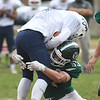 JIM VAIKNORAS/Staff photo Pentucket's Jordan Journeay makes a tackle on Rockland's Dante Vasquez during their game at Pentucket Saturday.