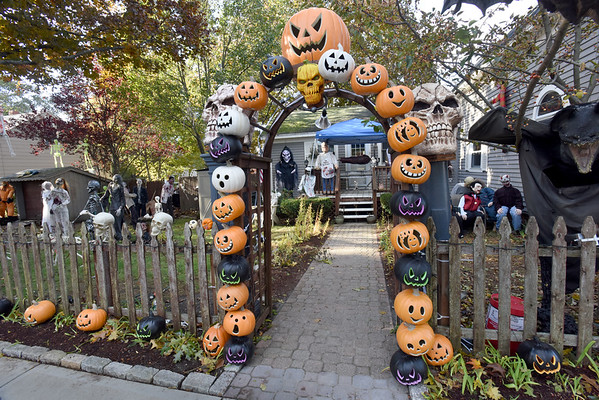 BRYAN EATON/Staff photo. The jack-o-lanterns are the least ghoulish on this Halloween display on 13 Tilton Street in Newburyport. Bruce Page and his family have been setting up all kinds of scary items on their all-out display they've been doing for many years.