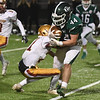JIM VAIKNORAS/Staff photo Pentucket's Owen Thornton is brought down by Newburyport's Trevor Ward during their game  Friday night at World War Memorial Stadium in Newburyport.