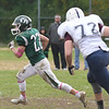 JIM VAIKNORAS/Staff photo Pentucket's Dylan O'Rourke turns the corner at home against Rockland Saturday.