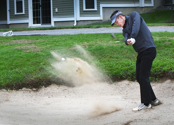 BRYAN EATON/Staff photo. Newburyport's Michael Twomey works his way out of the sand trap.