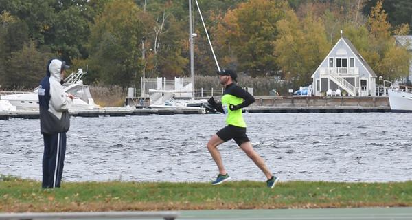 JIM VAIKNORAS/Staff photo A runner heads along the river at the Newburyport Half Marathon Sunday morning.