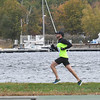 JIM VAIKNORAS/Staff photo A runner heads along the river at the Newburyport Half Marathon Sunday morning.