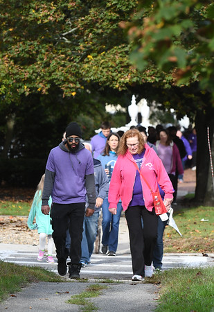 JIM VAIKNORAS/Staff photo Walker make their way down High Street Sunday morning in Newburyport in the annual Jeanne Geiger Crisis Center Annual Walk Against Domestic Violence