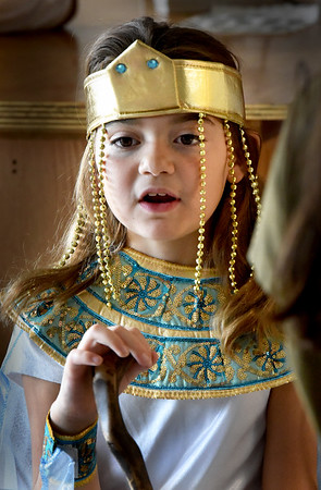 "BRYAN EATON/Staff photo. Harper Palermino, 9, brings the Egyptian queen Cleopatra to life at ""Dead and Famous"" at the River Valley Charter School where students researched and presented a person from history. It's become a tradition at the school where the children still dress up for Halloween but with an educational slant."