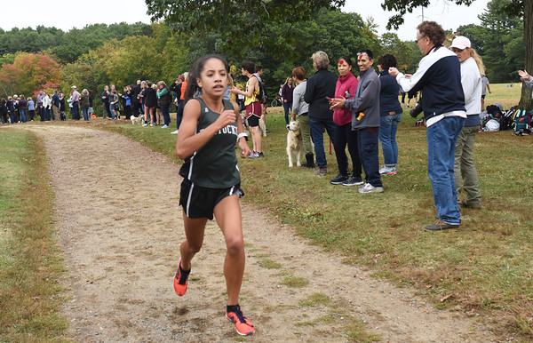 BRYAN EATON/Staff photo. Pentucket's Phoebe Rubio takes the first spot in the girls race.