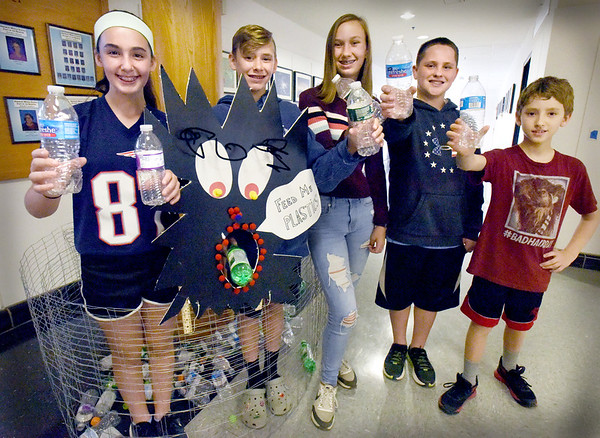 BRYAN EATON/Staff Photo. An Amesbury Middle School STEM team is working to rid water of plastic particles, from left, Calista Catarius, 13, Sam Guimaraes, 13, Natalie Welling, 13, Dylan Palen, 12, and Wesley Evans, 11.