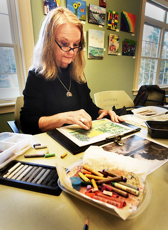 BRYAN EATON/Staff Photo. Kathy Seekamp of Newburyport works on a landscape in pastels at the Newburyport Senior and Community Center on Tuesday afternoon. The class overseen by artist Ann Harter and runs for an hour starting at 1:00 p.m. and is open to anyone with any skill level.