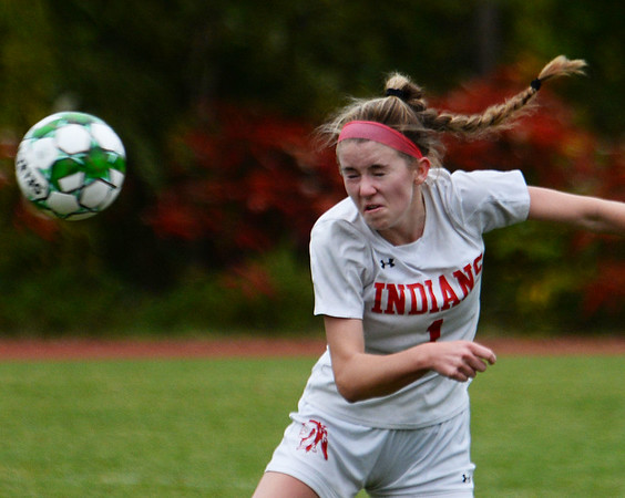 CARL RUSSO/staff photo. Amesbury's McKenna Hallinan heads the ball in soccer action against Pentucket Wednesday afternoon. 10/16/2019