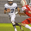 Hamilton-Wenham ian coffey carries the ball for a 52 yard gain  in a game against Amesbury Friday, October 18, at Landry Stadium.<br /> Photo by Nicole Goodhue Boyd