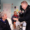 "Karen Robichaud Cameron photo. The ""Singing Trooper"" Daniel Clark gives his attention to Verna Hartman at the Hilton Senior Center in Salisbury during Veteran's Appreciation Day. The event was an opportunity for veterans, their families and friends to learn more about available benefits, services and resources. Attendees were treated to Charlie and his Hot Dog Cart, followed by an Ice Cream Social courtesy of Atria Merrimack Place."
