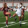 BRYAN EATON/Staff photo. Newburyport's Christine Good kicks the ball past Sara Riter.
