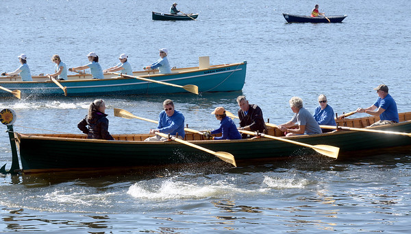 BRYAN EATON/Staff photo. The larger class of boats head out from Lowell's Boat Shop in Amesbury for the annual Mighty Merrimack Rowing Race. The race was held in conjunction with their Fall Haul and acompanied by live music, chili and other refreshment.