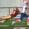 BRYAN EATON/Staff Photo. Lucas Stallard flies through the air in an attempt the Bedfod player who got their second touchdown.