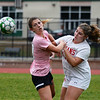 CARL RUSSO/staff photo. Pentucket's Annabelle Sylvanowicz fights for the ball with Amesbury's Gabby Smyth in soccer action Wednesday afternoon. 10/16/2019