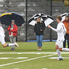 BRYAN EATON/Staff photo. Umbrellas were out in force at the sidelines at Georgetown High School as the soccer team hosted Newburyport. Rain is also in the forecast for tonight and into Friday morning with clearing later.