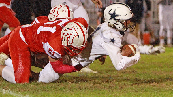 Hamilton-Wenham costs savignano  carries the ball as Amesbury colby turner tries to stop him Friday October 18, at Landry Stadium.<br /> Photo by Nicole Goodhue Boyd
