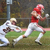 BRYAN EATON/Staff Photo. Masco's Jack Corcoran breaks away from Luke Young for a touchdown which was called back by a penalty.