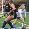 BRYAN EATON/Staff Photo. Meghan Bean gets the ball past Lynnfield defenders.