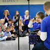 BRYAN EATON/Staff Photo. Noah Holt smiles as he gets applause after singing a song for his fellow students at an assembly for him at Amesbury Elementary School.