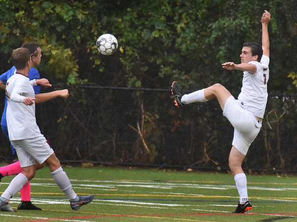 BRYAN EATON/Staff Photo. Newburyport defensman Cameron McDermott kicks the ball to the Georgetown side of the field.