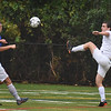 BRYAN EATON/Staff Photo. Newburyport defensman Cameron McDermott kicks the ball to the Georgetown side of the field.