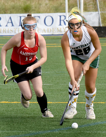 BRYAN EATON/Staff Photo. Pentucket's #28 heads down the field, Amesbury's Anna Perry in pursuit.
