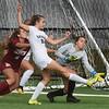 BRYAN EATON/Staff photo. Newburyport gets the ball past keeper Ashlynne Reade for their third goal.