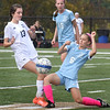 BRYAN EATON/Staff Photo. Triton's Morgan Hall slides into the ball as Maddy Rostad moves in.