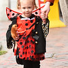 BRYAN EATON/Staff Photo. Dressed as a lady bug, Loxley Heyman, 2, of Manchester, N.H. walks along State Street in pursuit of goodies. She was visiting family members in Amesbury who decided to come to the downtown Newburyport event.