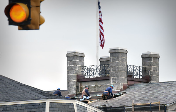 BRYAN EATON/Staff Photo. Workers remove the slate roof from the Custom House Maritime Museum which will be replaced with slate after the roof is checked for leakage and underlayment put down. The work on the building, completed in 1835, will go into December.