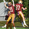 BRYAN EATON/Staff Photo. Trevor Ward, left, celebrates with Jason Tamayoshi after the latters touchdown.
