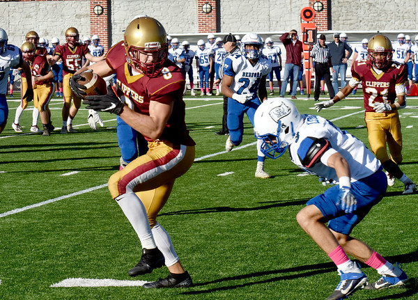 BRYAN EATON/Staff Photo. A Bedford player readies to tackle Walker Bartkiewicz after his pass reception.