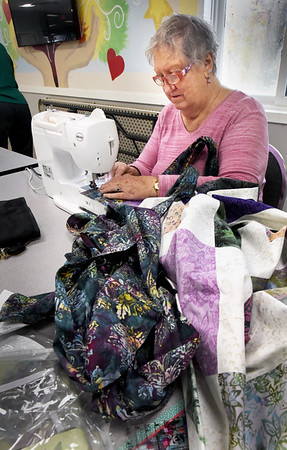 BRYAN EATON/Staff Photo. Phyllis Gudaitis and others work on their quilts at the Hilton Senior Center in Salisbury. The group, which meet on Tuesdays, donate their work to various local charities.
