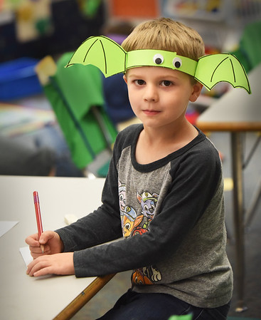 BRYAN EATON/Staff Photo. Daniel Morris, 5, and his fellow kindergartners in Aimee Farrell's class at Salisbury Elementary School made bat hats as they get in the Halloween spirit. The school holds its Halloween Parade on Thursday and Daniel will be losing the hat for that of a fireman's hat and uniform.