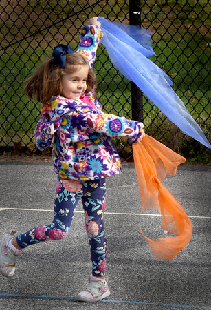 BRYAN EATON/Staff Photo. Bailey Millette, 4, and her pre-K classmates paraded around the basketball court at the Bresnehan School in Newburyport waving scarves. They were in physical therapist Jill Grelle's  weekly developmental motor group where the youngsters work on jumping, balance, throwing and other excercises.