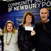 BRYAN EATON/Staff Photo. The Sean Perkins Foundation made a $5,000 donation to Community Services of Newburyport. From left, Martha Arias, assistant to the office administrator; Diann May, foundation board member; Rhonda Cameron, office administrator and Raymond Perkins, foundation board member and father of Sean Perkins.
