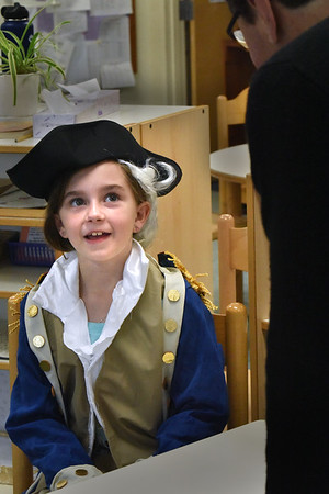 BRYAN EATON/Staff Photo. Some local school students are dressing up in costume, but not necessarily for Halloween. Phoebe Bouchard, 9, portrays George Washington at the River Valley Charter School on Thursday. The students in the upper elementary grades presented Dead and Famous where they researched a famous person from the past and brought them to life for parents and other students to learn from.