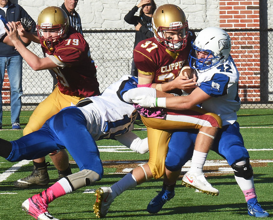 BRYAN EATON/Staff Photo. Bedford players strip the ball from Tamayoshi resulting in a fumble.
