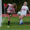 CARL RUSSO/staff photo. Pentucket's Katelyn Sudbay clears the ball out in front her net as Amesbury's Sophia Carter moves towards the ball in soccer action. 10/16/2019